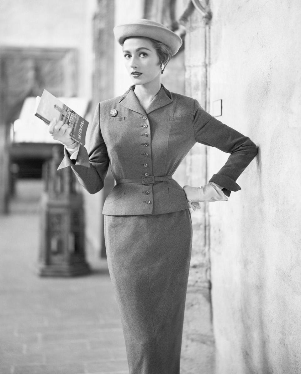 <p>A model wearing a contoured chesterfield suit. </p>