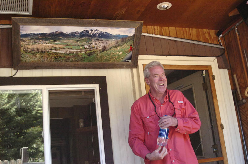 In this July 6, 2019, photo, Jeff Morehead stands near a panorama photo he took in 1994 of the Fish Creek Mobile Home Park and construction next door of the new Yampa River Botanic Park in Steamboat Springs, Colo. Some Colorado towns are taking action to preserve their remaining mobile home parks. Cities, counties and housing authorities, such as the Yampa Valley Housing Authority in Steamboat Springs, are buying mobile home parks to preserve affordable housing for residents as other mom-and-pop park owners sell out to developers or investors. (Matt Stensland/The Colorado Sun via AP)