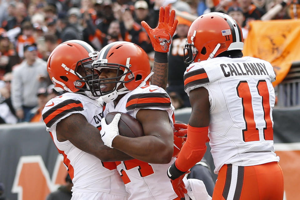 Cleveland Browns running back Nick Chubb, center, celebrates his touchdown with wide receivers Antonio Callaway (11) and Jarvis Landry, left, in the first half of an NFL football game against the Cincinnati Bengals, Sunday, Nov. 25, 2018, in Cincinnati. (AP Photo/Frank Victores)