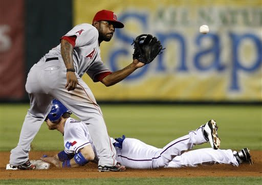 Los Angeles Angels second baseman Howard Kendrick waits for the throw as Texas Rangers' Craig Gentry steals second safely in the third inning of a baseball game Friday, May 11, 2012, in Arlington, Texas. (AP Photo/Tony Gutierrez)