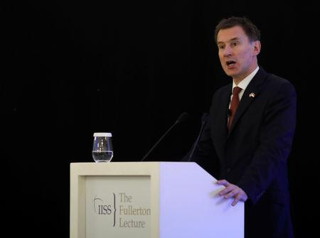 FILE PHOTO: Britain's Foreign Minister Jeremy Hunt speaks at the Fullerton Lecture