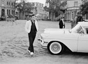"""<p>Presley brought his iconic gold Cadillac on tour with him to promote his film <em>Tickle Me</em>. The custom-made car was outfitted with luxury features, including gold-trimmed seats and a <a href=""""https://www.usmoneyreserve.com/video-library/videos/elvis-presleys-1960-gold-cadillac-did-you-know/"""" rel=""""nofollow noopener"""" target=""""_blank"""" data-ylk=""""slk:gold-plated TV"""" class=""""link rapid-noclick-resp"""">gold-plated TV</a>. The rock star bought the automobile <a href=""""https://www.graceland.com/blog/posts/elvis-presley-and-the-gold-cadillac-tour"""" rel=""""nofollow noopener"""" target=""""_blank"""" data-ylk=""""slk:from Southern Motors for $11,064.25"""" class=""""link rapid-noclick-resp"""">from Southern Motors for $11,064.25</a> in 1959 and continued to add upgrades over the next few years.</p>"""