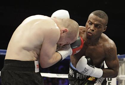 Peter Quillin (R) punches Lukas Konecny during their WBO Middleweight World Champion boxing match last April. (AP)