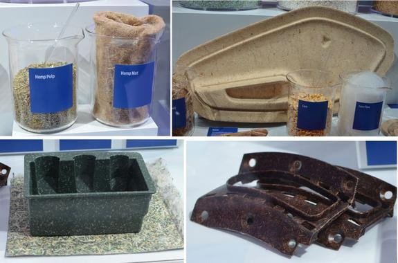 A display of futuristic materials by Ford. These are composite materials derived from renewable plant-based sources. Clockwise from top left: hemp fibers and pulp, kenaf fiber reinforced door inner panel and corn fibers in a beaker, shredded U.