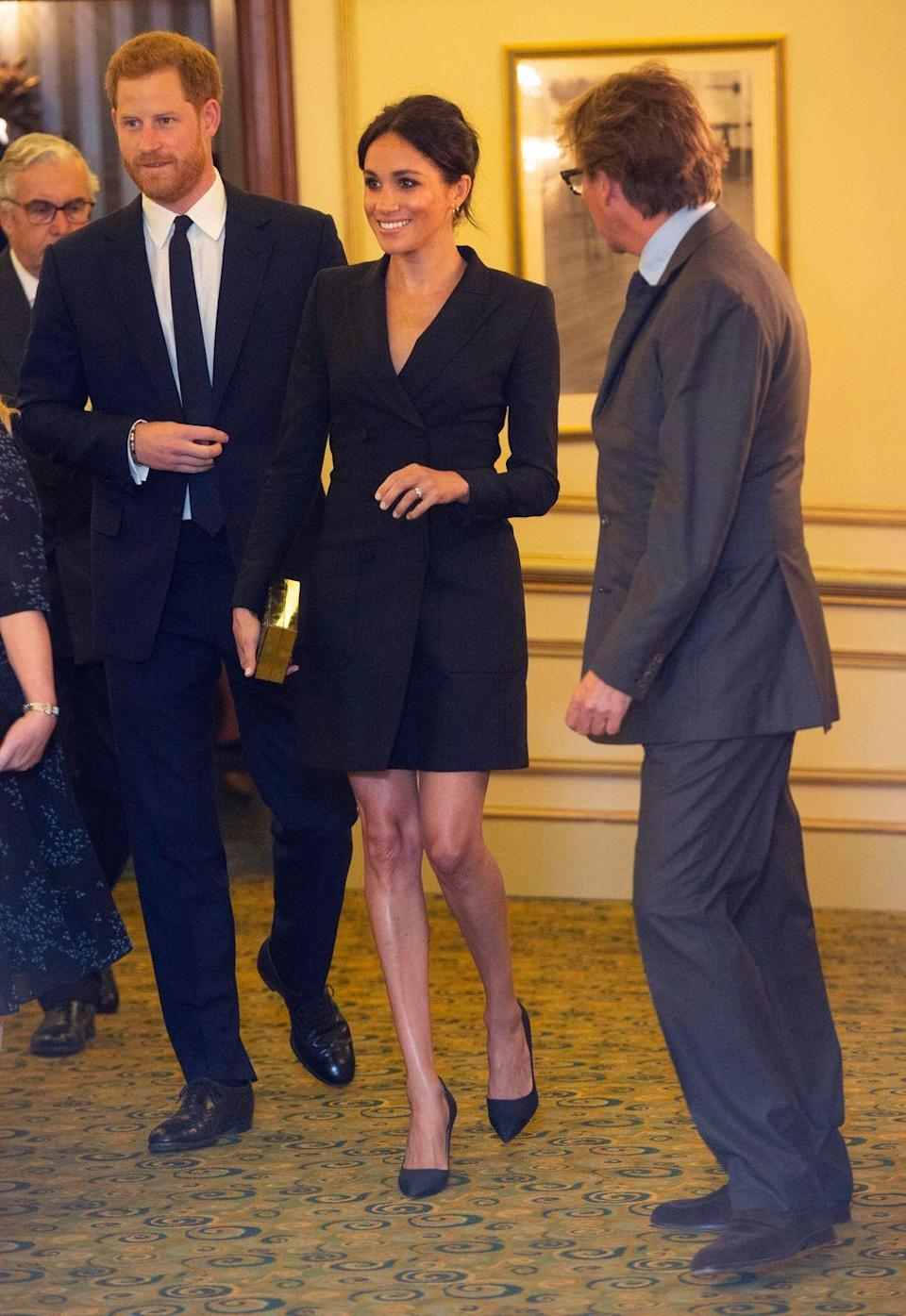 """<p>Meghan arrives at a performance of <em>Hamilton</em> wearing a sleek black mini dress from Canadian brand Judith & Charles. <a href=""""https://www.townandcountrymag.com/style/fashion-trends/a22861883/meghan-markle-black-mini-dress-judith-charles-hamilton-sentebale-gala/"""" rel=""""nofollow noopener"""" target=""""_blank"""" data-ylk=""""slk:Get all the details on her look here."""" class=""""link rapid-noclick-resp"""">Get all the details on her look here.</a></p>"""
