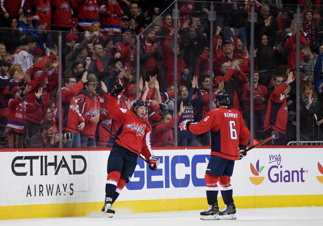 Washington Capitals center Nicklas Backstrom, left, of Sweden, celebrates his goal with defenseman Michal Kempny (6) during the first period of an NHL hockey game against the New Jersey Devils, Saturday, April 7, 2018, in Washington. (AP Photo/Nick Wass)