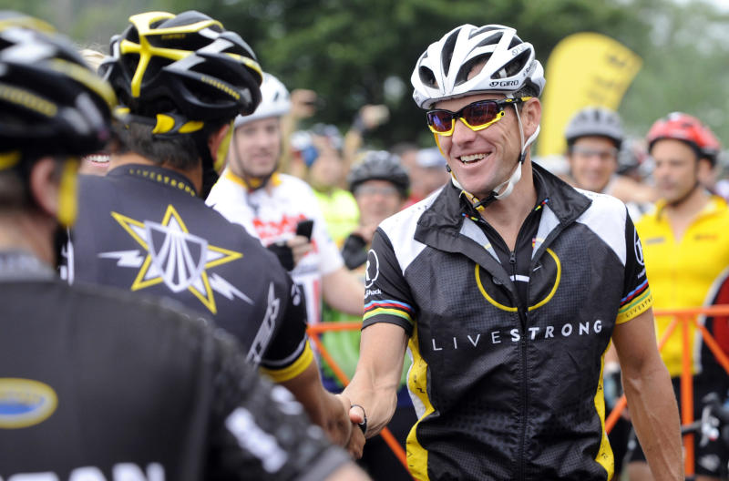 FILE - In this Aug. 22, 2010, file photo, cyclist Lance Armstrong greets fellow riders prior to the start of his Livestrong Challenge 10K ride for cancer in Blue Bell, Pa. Even after whistleblowers unveiled their scathing report portraying Armstrong as an unrepentant drug cheat, the argument over what to make of his life story rages on. (AP Photo/Bradley C Bower, File)
