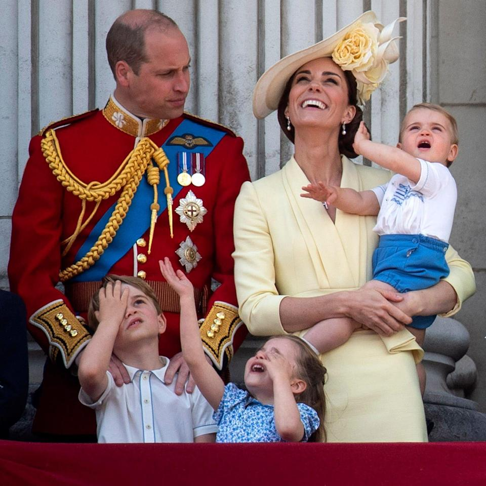 The Duke and Duchess of Cambridge with their children, Prince Louis, Prince George, Princess Charlotte, on the balcony of Buckingham Place in 2019 - PA
