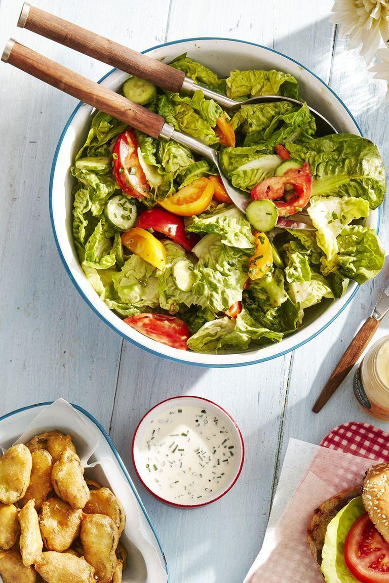 """<p>Craving something nutritious after a day full of indulging? This salad is healthy but still super flavorful thanks to a variety of fresh herbs.</p><p><strong><a href=""""https://www.countryliving.com/food-drinks/a28188449/tossed-salad-with-green-goddess-dressing-recipe/"""" rel=""""nofollow noopener"""" target=""""_blank"""" data-ylk=""""slk:Get the recipe"""" class=""""link rapid-noclick-resp"""">Get the recipe</a>.</strong> </p>"""