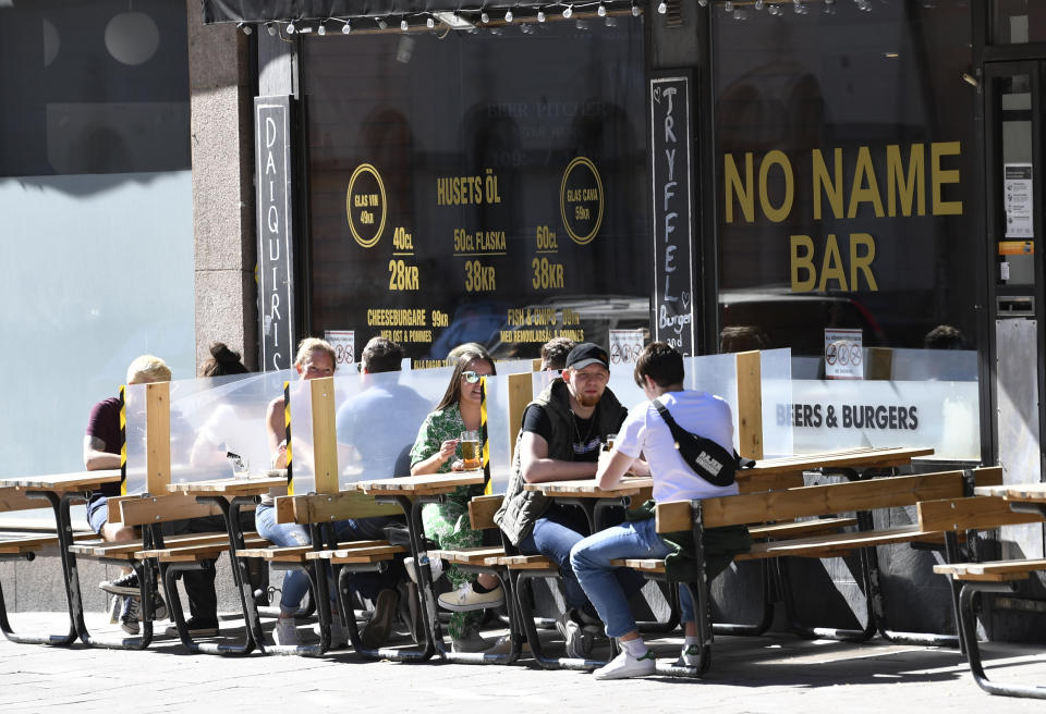 Screens protect customers sitting outside in Sweden over the weekend. Source: AAP
