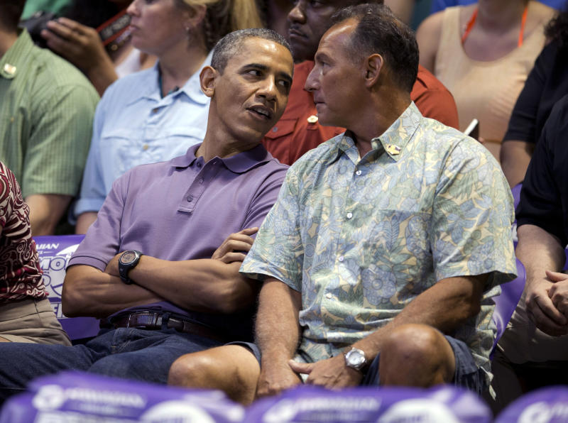President Barack Obama sits with longtime friend Bobby Titcomb during the Oregon State University versus University of Akron college basketball game at the Diamond Head Classic at the Stan Sheriff Center in Honolulu, Sunday, Dec. 22, 2013. Michelle Obama's bother, Craig Robinson, is the coach of Oregon State. The first family is in Hawaii for their annual holiday vacation. (AP Photo/Carolyn Kaster)