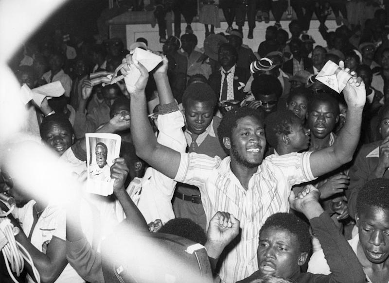 Residents of Salisbury cheer during the proclamation of independence for the nation of Zimbabwe in April 1980.