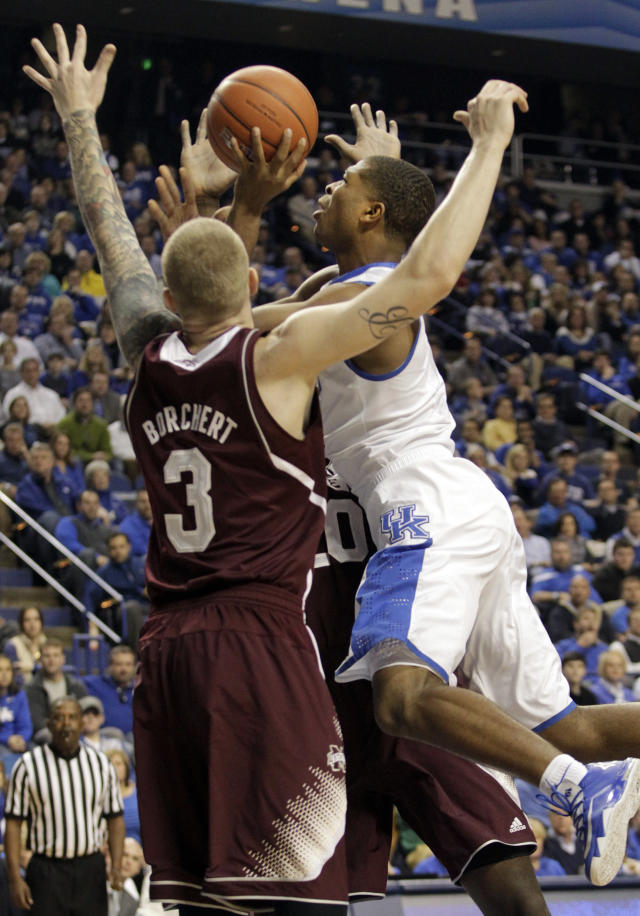 Kentucky's Aaron Harrison, right, shoots next to Mississippi State's Colin Borchert (3) during the first half of an NCAA college basketball game, Wednesday, Jan. 8, 2014, in Lexington, Ky. (AP Photo/James Crisp)