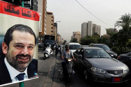 Cars pass next to a poster depicting Saad al-Hariri, who has resigned as Lebanon's prime minister, in Beirut, Lebanon,, Lebanon, November 13, 2017. REUTERS/Mohamed Azakir