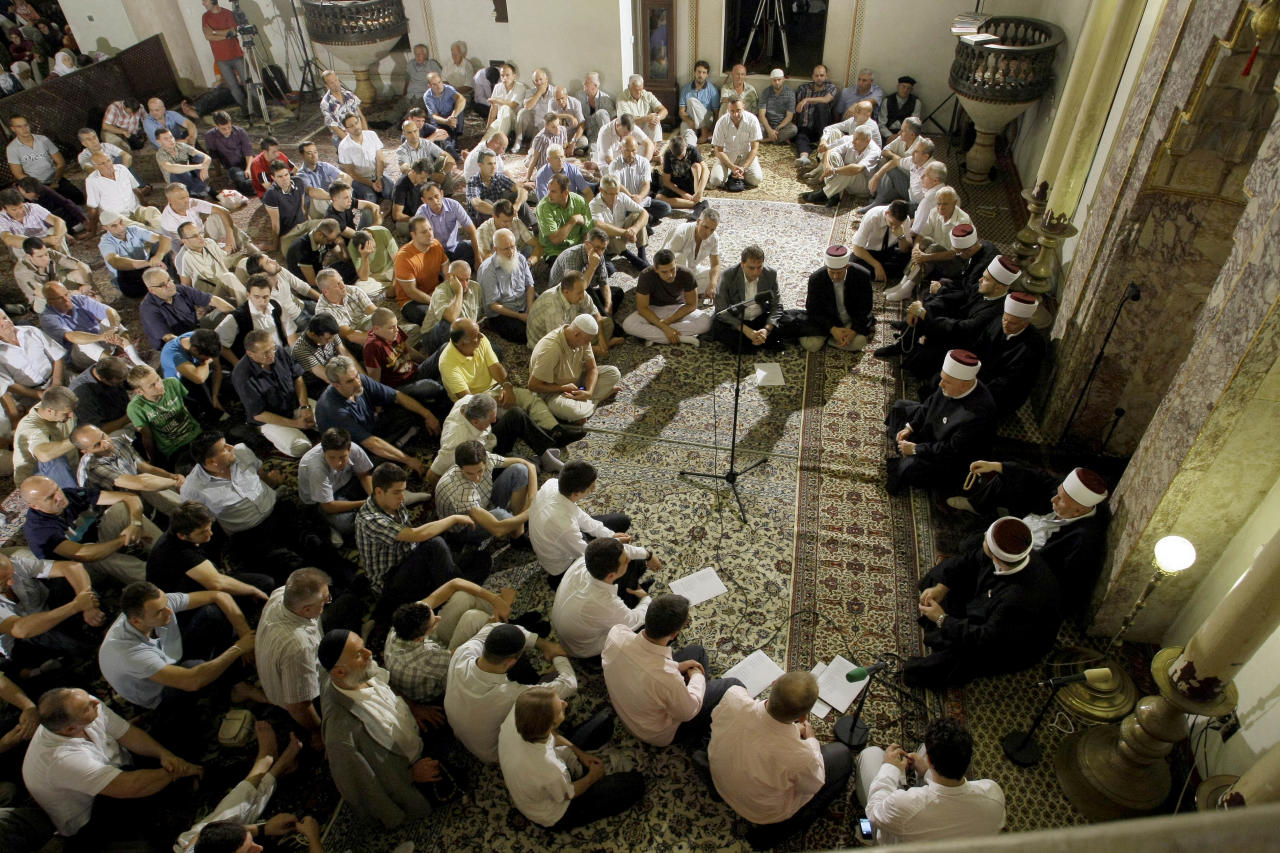 Bosnian Muslims pray at the Begova Mosque during the 27th night of the holy fasting month of Ramadan, Laylat al-Qadr (Night of Decree), in downtown Sarajevo, Bosnia, late night on Friday, Aug. 26, 2011. The night is the most important night for prayer in the month of Ramadan, holiest month where Muslims fast from dawn to dusk. (AP Photo/Sulejman Omerbasic)