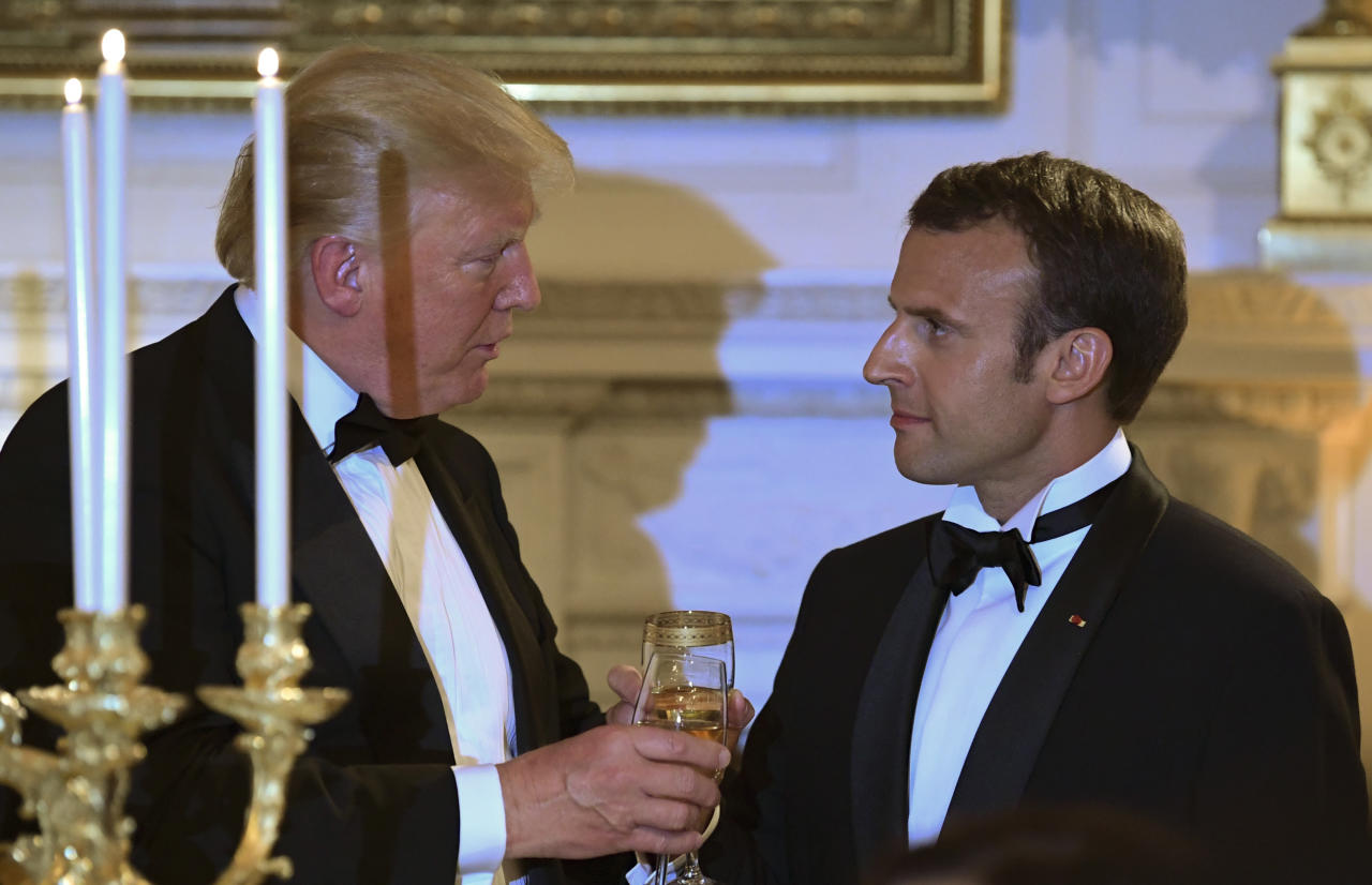 President Donald Trump, left, and French President Emmanuel Macron, right, share a toast during the State Dinner at the White House in Washington, Tuesday, April 24, 2018. (AP Photo/Susan Walsh)