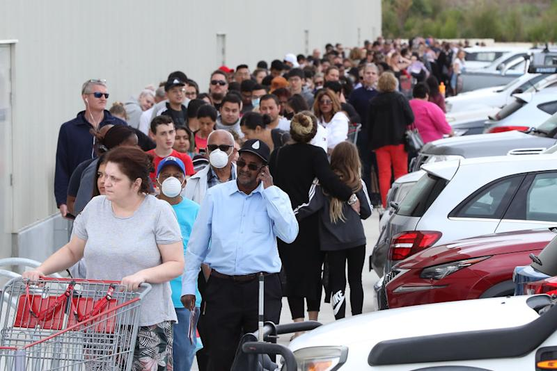 PERTH, AUSTRALIA - MARCH 19: Shoppers line up around the building waiting to enter at Costco Perth on March 19, 2020 in Perth, Australia. (Photo by Paul Kane/Getty Images)