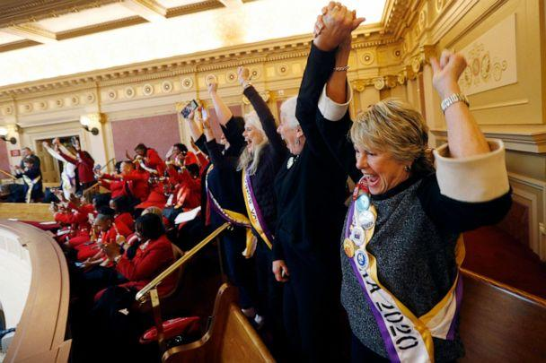 PHOTO: Equal Rights Amendment supporter Donna Granski, right, from Midlothian Va., cheers the passage of the House ERA Resolution in the Senate chamber at the Capitol in Richmond, Va., Jan. 27, 2020. The resolution passed 27-12. (Steve Helber/AP)