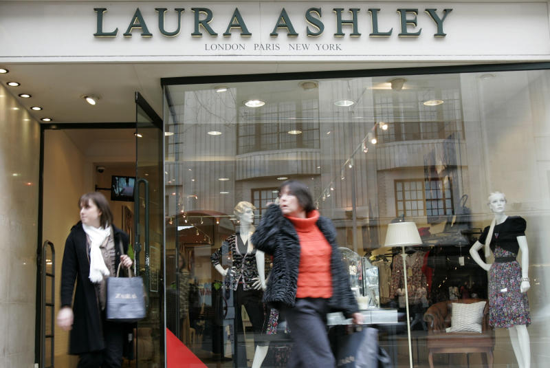 Pedestrians walk past a Laura Ashley store in London's Kensington High Street, Tuesday, Feb. 17, 2009. Shares in Laura Ashley Holdings PLC fell Tuesday after the company warned of lower than expected profits for the year ending Jan. 31, due to the recession in Britain, the falling value of the pound and higher spending on promotions. (AP Photo/ Alastair Grant)