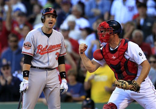 Baltimore Orioles' Ryan Flaherty, left, reacts after striking out on a pitch by Boston Red Sox's Andrew Bailey to end the game in the ninth inning as Red Sox catcher Ryan Lavarnway, right, celebrates the Red Sox 2-1 victory at Fenway Park, in Boston, Sunday, Sept. 23, 2012. (AP Photo/Steven Senne)