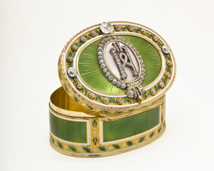 """An imperial presentation box by Faberge workmaster Mikhail Perkhin is shown in this undated photo from the Houston Museum of Natural Science. The gold and diamond box is on display at the museum as part of the largest private collection in the United States of items from the Russian artisan Peter Carl Faberge. Featuring more than 350 objects, the exhibit """"Fabergé: A Brilliant Vision,"""" runs through Dec. 31, 2013 at the Houston Museum of Natural Science. (AP Photo/Houston Museum of Natural Science)"""