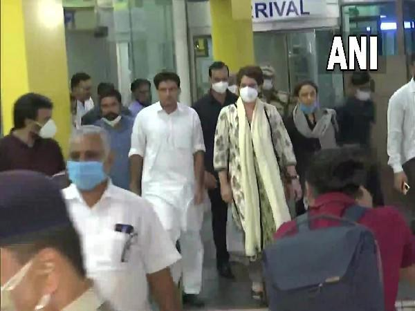 Congress General Secretary Priyanka Gandhi Vadra (in cream coloured outfit) arrives in Lucknow (Photo/ANI)