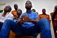 Ugandan presidential candidate Robert Kyagulanyi also known as Bobi Wine sits inside a courtroom in Iganga