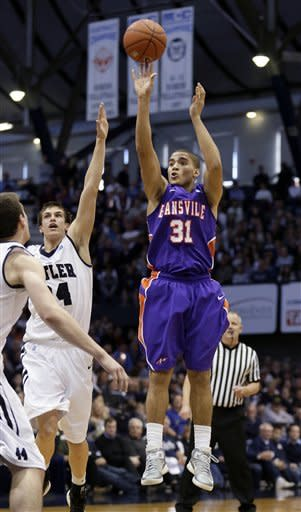 Evansville guard D.J. Balentine (31) shoots in front of Butler guard Kellen Dunham (24) during the second half of an NCAA college basketball game, Saturday, Dec. 22, 2012, in Indianapolis. Butler won 75-67. (AP Photo/AJ Mast)