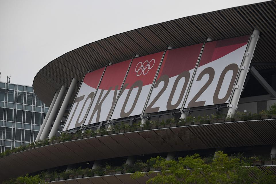 The logo of Tokyo 2020 is displayed at the National Stadium, main venue for the Tokyo 2020 Olympic and Paralympic Games in Tokyo on July 7, 2021, as reports said the Japanese government plans to impose a virus state of emergency in Tokyo during the Olympics. (Photo by Kazuhiro NOGI / AFP) (Photo by KAZUHIRO NOGI/AFP via Getty Images)