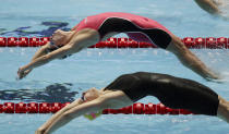 File-This July 28, 2019, file photo shows the United States' Regan Smith starting the backstroke leg in the women's 4x100m medley relay final at the World Swimming Championships in Gwangju, South Korea. Katie Ledecky is among several big names diving back in with three months to go until the U.S. Olympic trials. Caeleb Dressel, Simone Manuel, double backstroke world-record holder Smith, and Ryan Lochte will swim over four days in the first single-site American meet since the pandemic began. (AP Photo/Mark Schiefelbein, File)