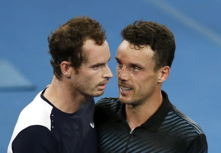 Tennis - Australian Open - First Round - Melbourne Arena, Melbourne, Australia, January 14, 2019. Britain's Andy Murray and Spain's Roberto Bautista Agut greet each other after the match. REUTERS/Edgar Su