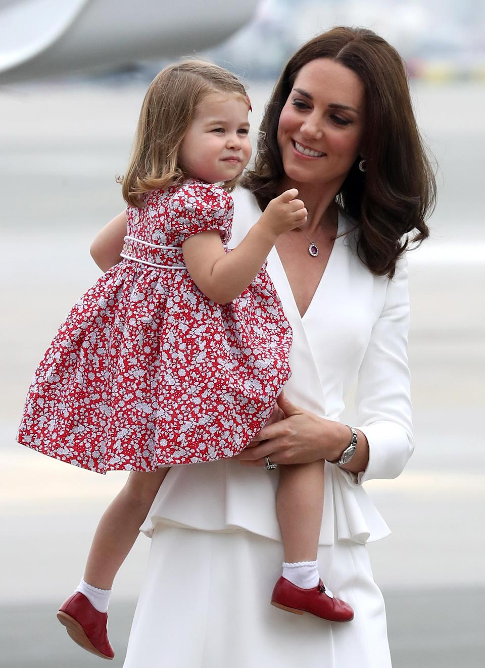<p>In this adorable shot, Kate Middleton looks to be staring at her daughter Princess Charlotte with such love and awe.</p>