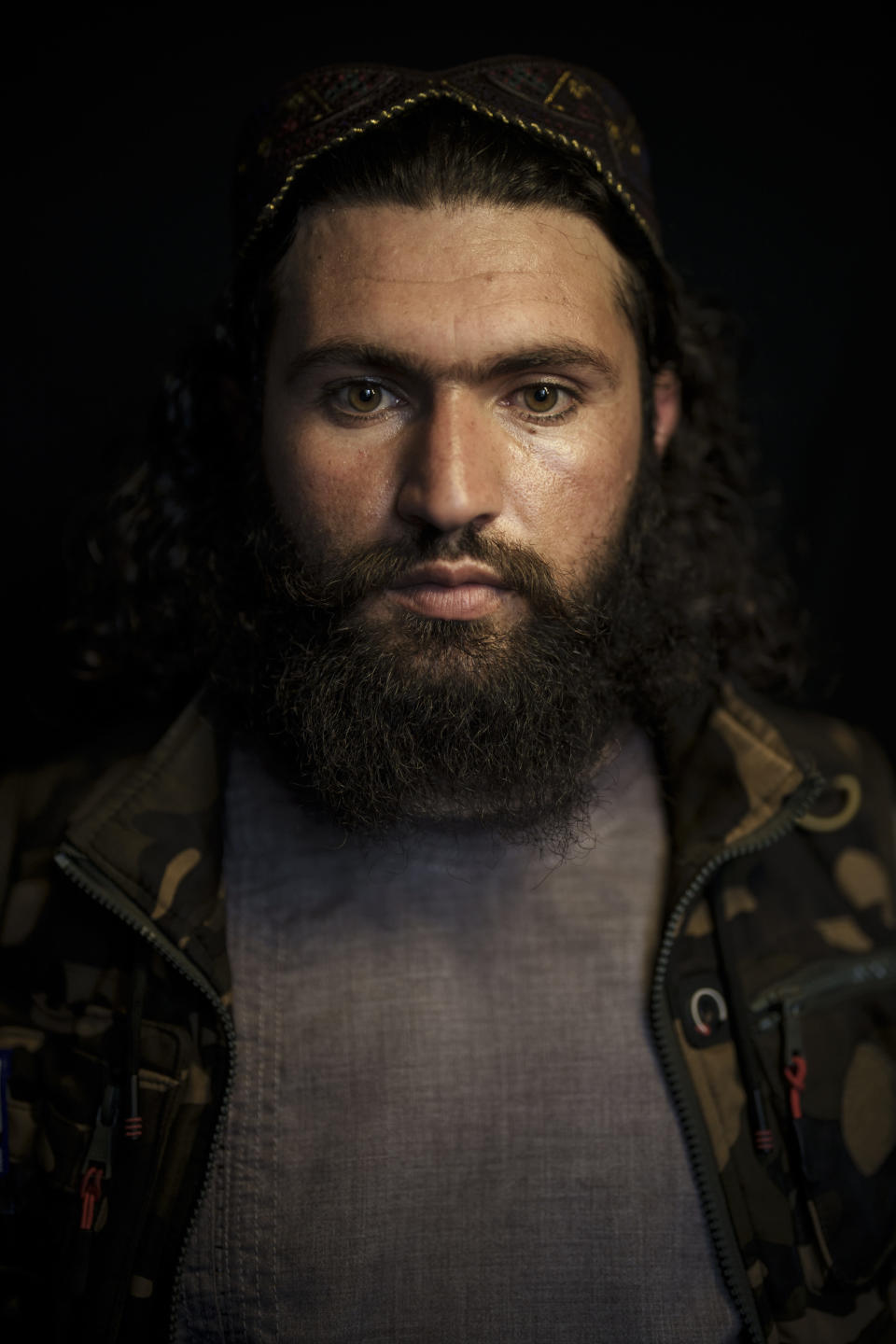 Taliban fighter Shirullah Badri, police chief of district 12, poses for a portrait at his office in Kabul, Afghanistan, Monday, Sept. 20, 2021. Badri says he's been a Taliban for most of his life. He lost his three brothers and many close friends in the war. (AP Photo/Felipe Dana)