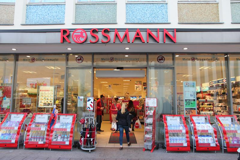 People visit Rossmann cosmetics store in Lubeck, Germany. As of 2011 Rossmann had 2,531 stores and 31,000 employees.