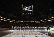 """<p>Fans join in unison to sing a stirring rendition of the """"Star-Spangled Banner."""" (Bruce Bennett/Getty Images) </p>"""