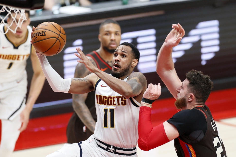 Monte Morris #11 of the Denver Nuggets shoots against Jusuf Nurkic #27 of the Portland Trail Blazers  in the third quarter during Round 1, Game 6 of the 2021 NBA Playoffs at Moda Center on June 03, 2021 in Portland, Oregon. NOTE TO USER: User expressly acknowledges and agrees that, by downloading and or using this photograph, User is consenting to the terms and conditions of the Getty Images License Agreement. (Photo by Steph Chambers/Getty Images)