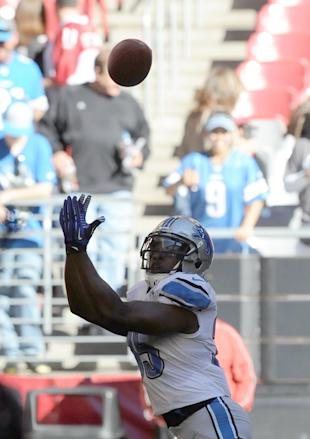 Joique Bell attempts to catch a pass (Photo by Norm Hall/Getty Images)