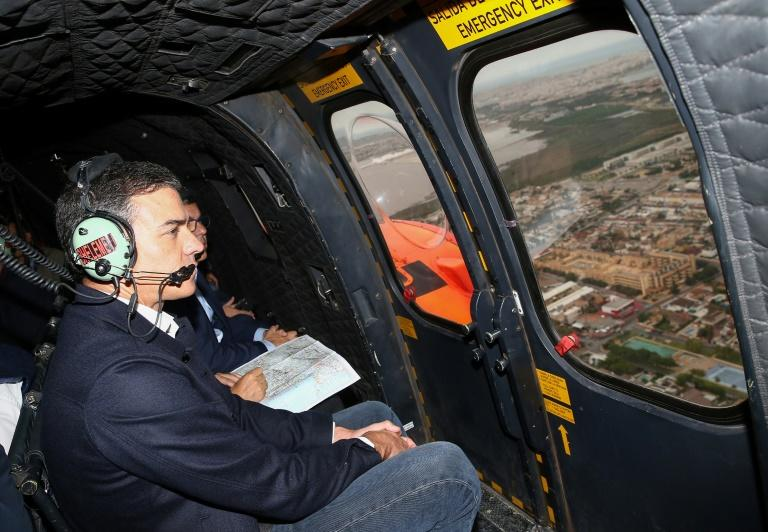 Sanchez flew over the affected areas and then visited a command centre (AFP Photo/Fernando CALVO)