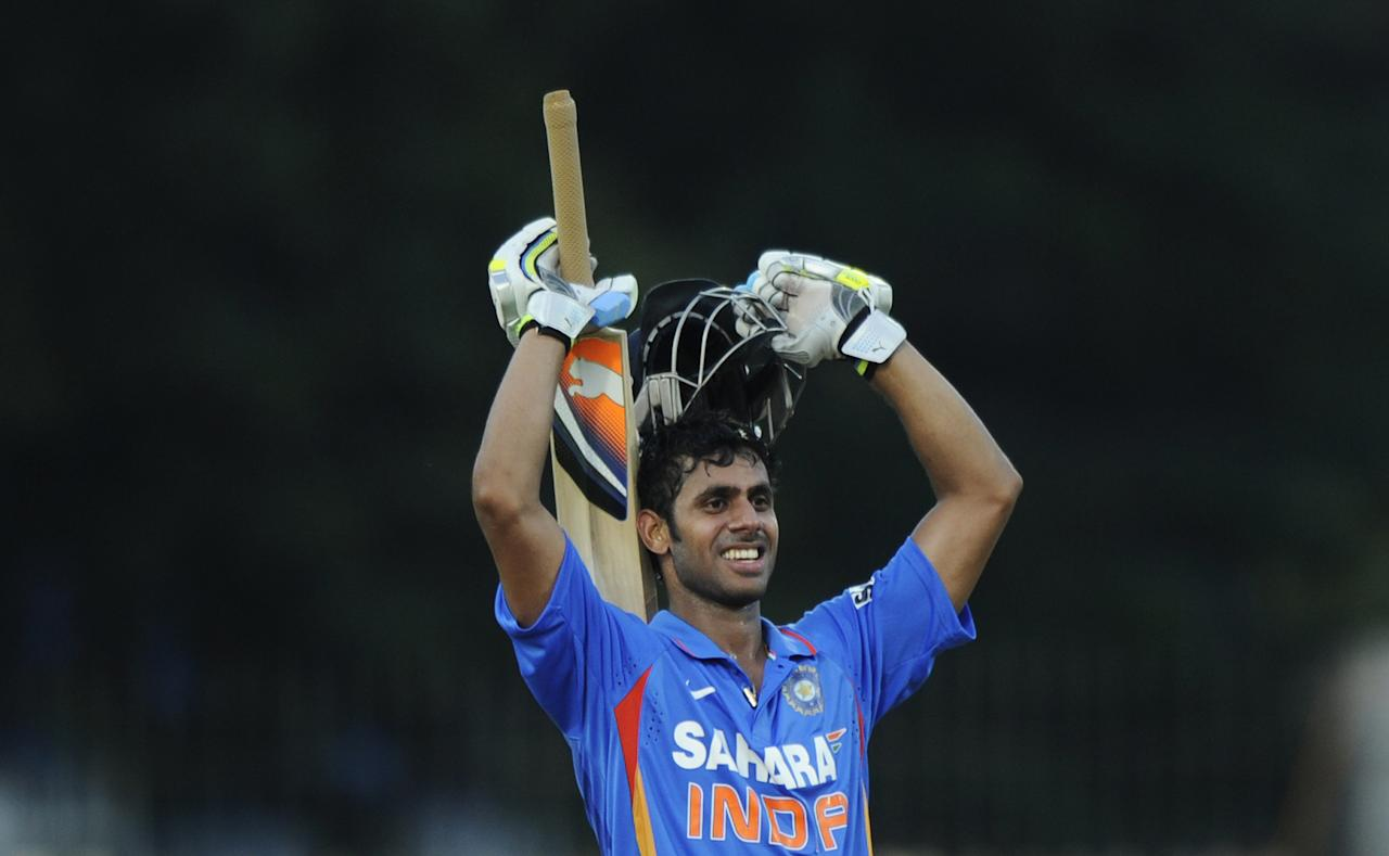 Indian Manoj Tiwary celebrates scoring a century (100 runs) during the final One Day International (ODI) cricket match between India and West Indies at The M.A.Chidambaram Stadium in Chennai on December 11, 2011. AFP PHOTO/Dibyangshu SARKAR (Photo credit should read DIBYANGSHU SARKAR/AFP/Getty Images)