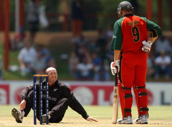 BLOEMFONTEIN - MARCH 8: Chris Harris of New Zealand and Heath Streak of Zimbabwe share a laugh during the Cricket World Cup Super Six match between New Zealand and Zimbabwe held at Goodyear Park in Bloemfontein, South Africa on March 8, 2003. (Photo by Nick Laham/Getty Images)