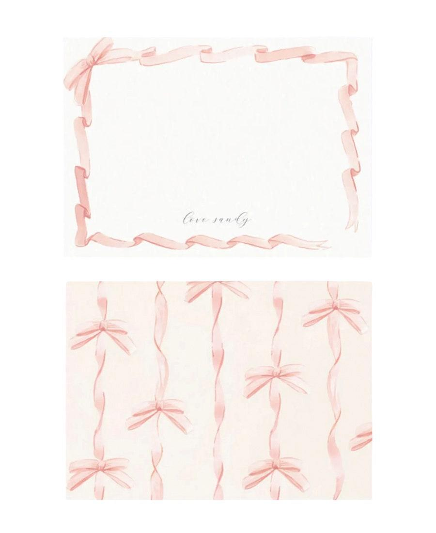 """Personalized stationery can be expensive, but Papier makes high-quality designs at a great price, like this 10-piece set that comes out to $2.80 a pop. Monogram it with the couple's names or a thoughtful message. $28, Papier. <a href=""""https://www.papier.com/us/blush-ribbon-25351"""" rel=""""nofollow noopener"""" target=""""_blank"""" data-ylk=""""slk:Get it now!"""" class=""""link rapid-noclick-resp"""">Get it now!</a>"""