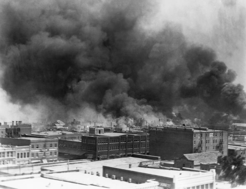 Black smoke billows from fires during the race riot of 1921 in Tulsa, Oklahoma. (Photo by © CORBIS/Corbis via Getty Images)