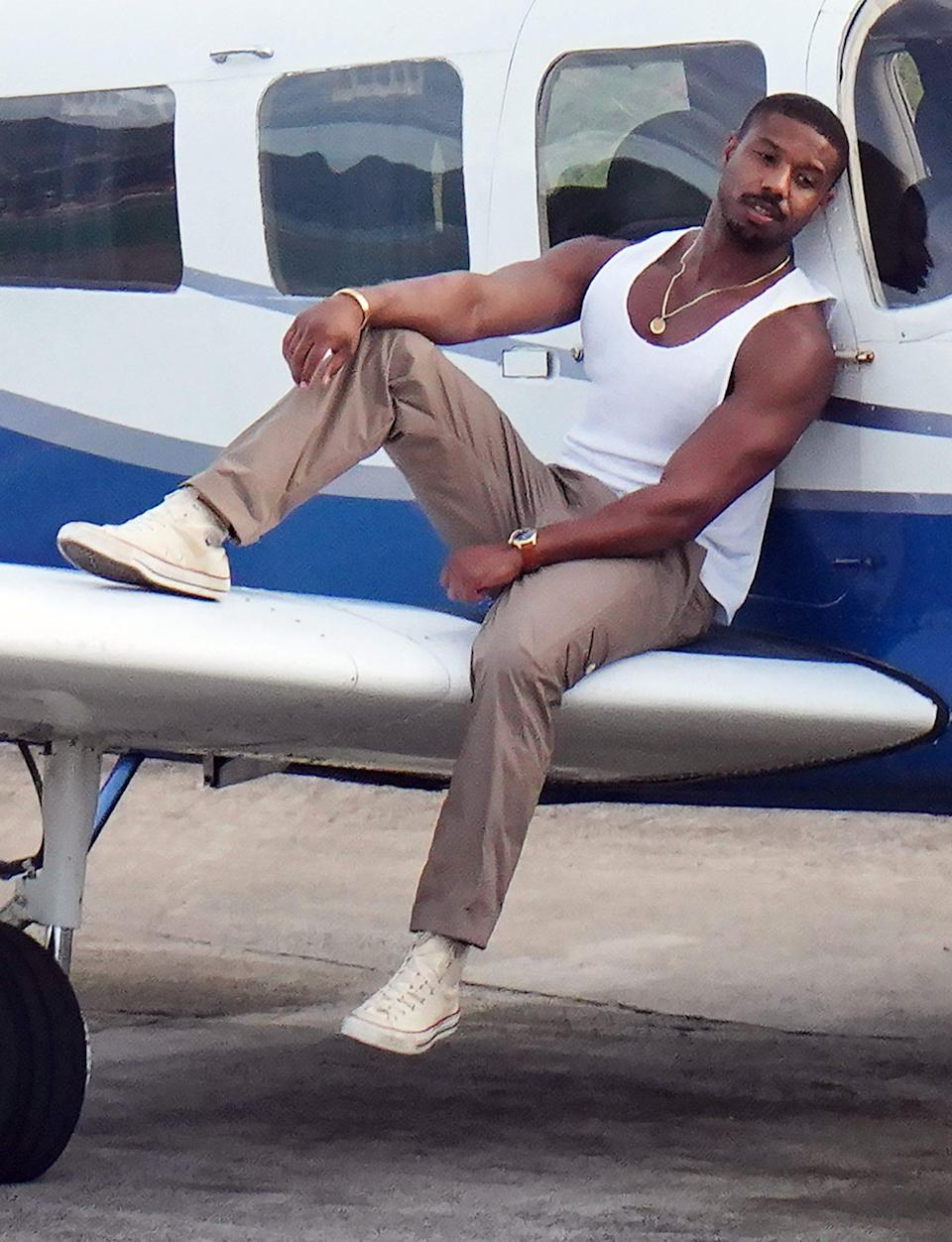 <p>Michael B. Jordan sizzles in a tank top and gold accessories during his photoshoot for <em>Men's Health</em> on Monday in St. Bart's.</p>