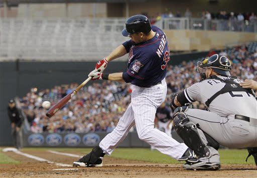Minnesota Twins' Justin Morneau hits a fielder's choice RBI against Chicago White Sox starting pitcher Hector Santiago during the third inning of a baseball game, Monday, May 13, 2013, in Minneapolis. (AP Photo/Genevieve Ross)