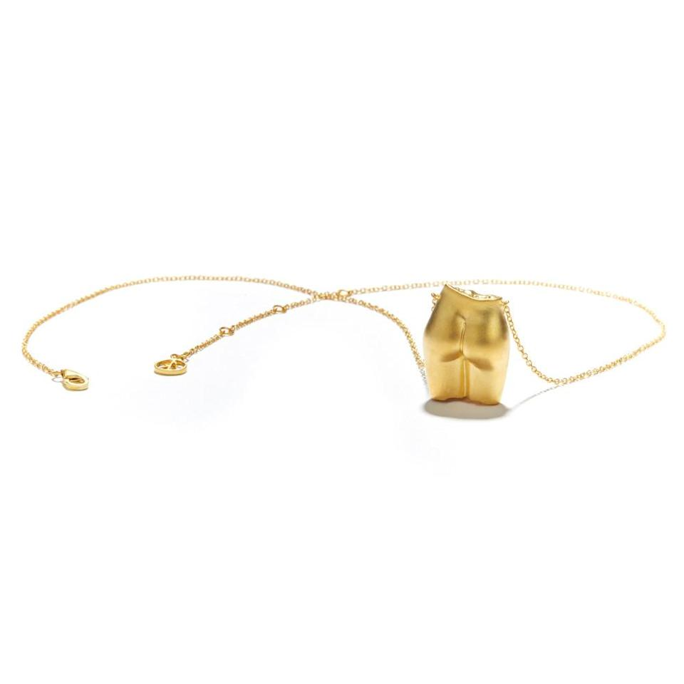 """<p>The """"gold-plated, highly polished derrière necklace"""" is part of Goop's Valentine's Day gift guide for women because which lucky lady could resist such a cheeky gift? </p>"""