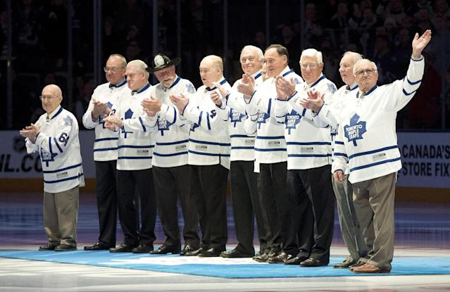 Members of the 1964 Stanley Cup winning Toronto Maple Leafs are honored before the Maple Leafs play the Vancouver Canucks in an NHL hockey game, Saturday, Feb. 8, 2014 in Toronto. (AP Photo/The Canadian Press, Frank Gunn)