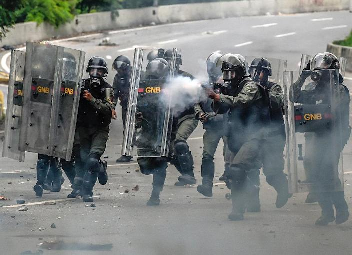 National Guard fire tear gas at opposition activists during a protest against Venezuelan President Nicolas Maduro, in Caracas (AFP Photo/JUAN BARRETO)