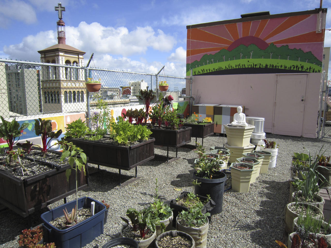 This undated photo courtesy of Joyce Sood for the GLIDE Foundation shows the rooftop garden at the Glide Memorial Church in San Francisco. As more people turn to roof gardens to grow their own food, they are coming up with all kinds of ways to keep those gardens light and avoid sagging and cave-ins.