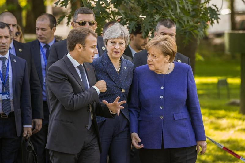Theresa May with Emmanuel Macron, president of France and Angela Merkel, chancellor of Germany
