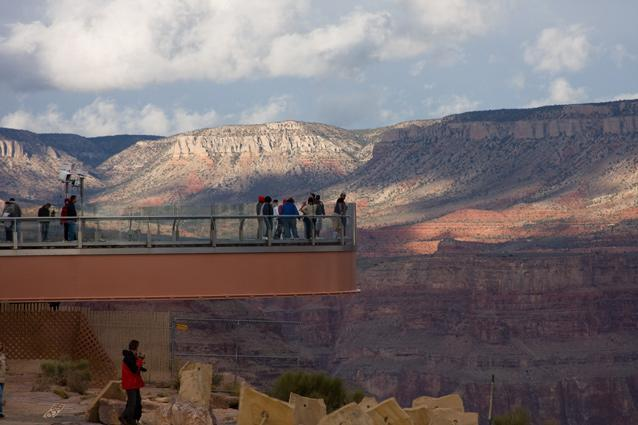 The Grand Canyon Skywalk. Photo: John Wood - The Grand Canyon Skywalk is a horseshoe-shaped cantilevered bridge with a glass base that juts out over the canyon in the Grand Canyon West area. Located at a height of 4,770ft, the views are spellbinding and the canyon's famous blazing sunrises and sunsets take on an entirely different character here. Note that personal belongings such as cameras are not permitted on to the Skywalk.